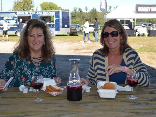 Lisa Robbins of Millville and Tammi Reynolds of Newport enjoy lunch during the Italian Festival at Bellview Winery.