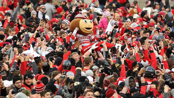 Brutus Buckeye crowd surfs as fans surge onto the field