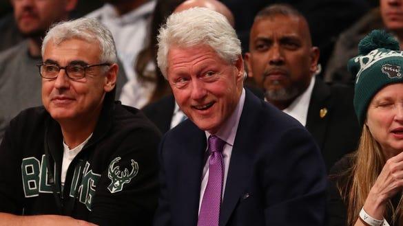 Former USA President Bill Clinton attends a game between