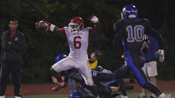 North Rockland's Jayden Cook (6) looks for some running