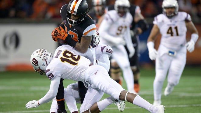 Oregon State receiver Jordan Villain is tackled by Arizona State's James Johnson during the second quarter.