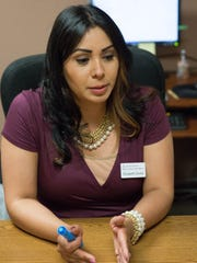 Elizabeth Zavala , an accredited representative and victim advocate with the Catholic Charities of Southern New Mexico, discusses the free legal advice she gives to immagrants that might be victims of crimes. Catholic Charities was offering in honor of the Santo Toribio Feast Day, Thursday, May 25,2017