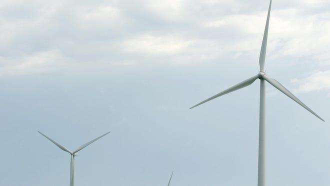 The blades of wind turbines turn in a wind farm east of Brookings off of US Highway 14. (Lara Neel/Argus Leader)