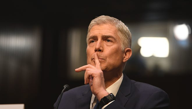Appeals court Judge Neil Gorsuch testifies Monday before the Senate Judiciary Committee as his confirmation hearing began. If confirmed, Gorsuch would fill the late Antonin Scalia's seat. The committee is slated to vote April 3 on Gorsuch's nomination.