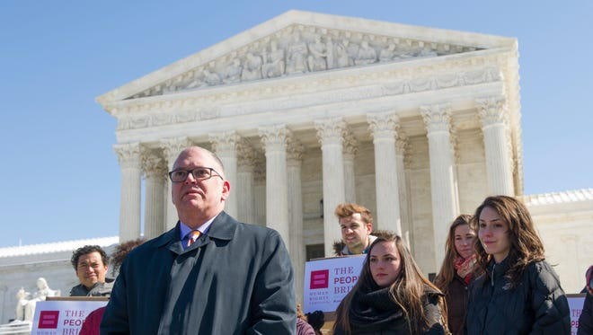 Jim Obergefell, lead plaintiff in the 2015 same-sex marriage case, speaks before helping to deliver briefs in the case.