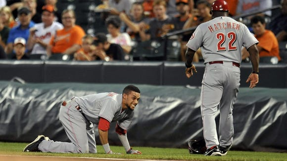Reds center fielder Billy Hamilton ran into first base umpire Mike DiMuro in the first inning of Tuesday's game in Baltimore. Hamilton stayed in the game, DiMuro did not.