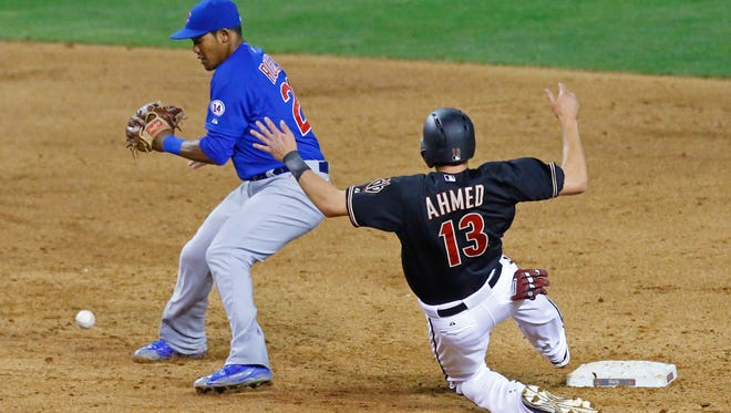 Arizona Diamondbacks baserunner Nick Ahmed slides safely into second base as Chicago Cubs second baseman Addison Russell (22) bobbles the ball in the fifth inning on Saturday, May 23, 2015 at Chase Field in Phoenix.
