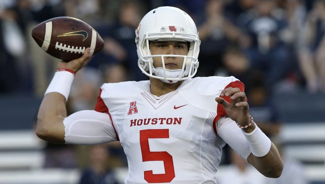 As Houston's quarterback in 2013, John O'Korn passed for 3,117 yards and 28 TDs against 10 INTs. He was benched after five starts in 2014, and transferred to Michigan.