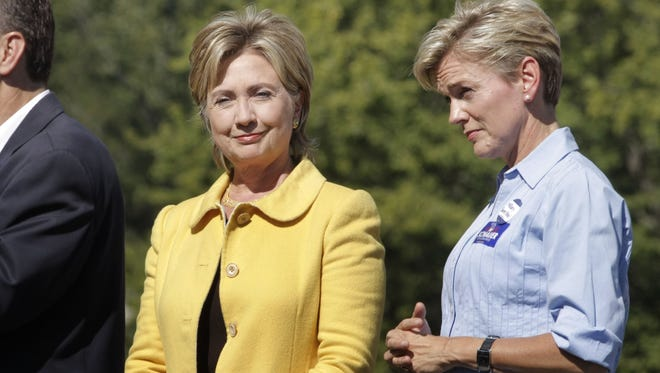 """Then-U.S. Sen. Hillary Clinton, D-N.Y., and then-Michigan Gov. Jennifer Granholm attend a """"Change We Need"""" rally  Sept. 27, 2008, in Grand Ledge."""