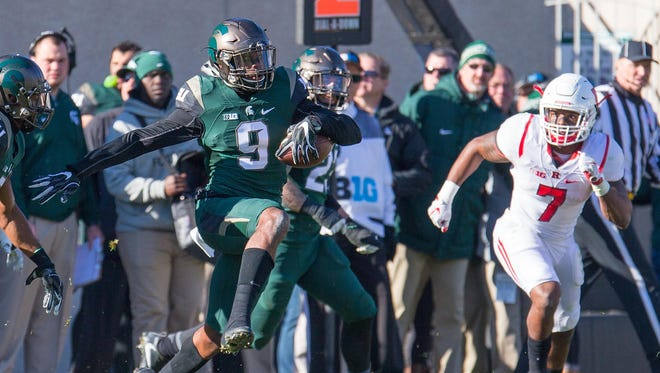 Michigan State Spartans safety Montae Nicholson intercepts a pass in the second half against Rutgers at Spartan Stadium on Nov. 12, 2016.
