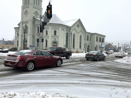 Falling snow coats city streets in downtown Elmira