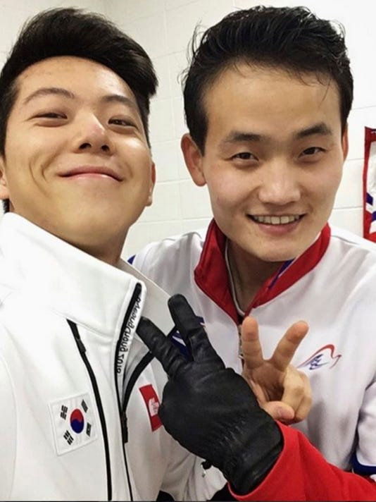 This February 2018 selfie provided by South Korean figure skater Alex Kam and posted on Instagram, shows him, left, posing with North Korean skater Kim Ju Sik in Gangneung, South Korea, ahead of the 2018 Winter Olympics. (Alex Kam via AP)