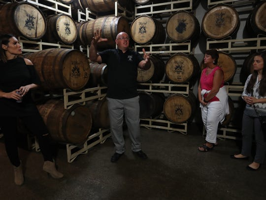 File photo of a tour at the Wicked Dolphin distillery in Cape Coral.