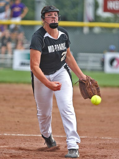 Mid-Prairie's ( Wellman ) pitcher #20 Taylor Kurtz fired in a pitch against East Marshall in Class 3-A quarterfinal game at the 2014 Girls State Softball Tournament in Ft. Dodge on Monday July 21, 2014.