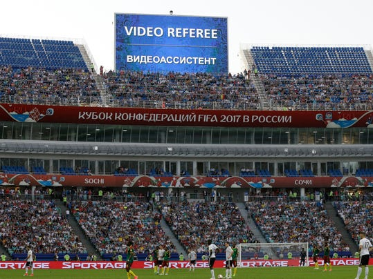 FILE - In this Sunday, June 25, 2017 file photo, a giant screen reports an incident is being investigated by VAR (Video Assistant Referee) during the Confederations Cup, Group B soccer match between Germany and Cameroon, at the Fisht Stadium in Sochi, Russia. FIFA has briefed coaches on how video assistant referees will operate at the World Cup. Although some trials have created additional confusion in games, soccer's most significant adoption of technology is set to be formally voted into the laws of the game at a meeting on Saturday, March 3, 2018. (AP Photo/Thanassis Stavrakis, file)