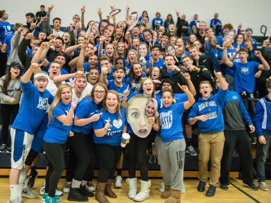 Harper Creek students cheer their team on during regional finals against Paw Paw.