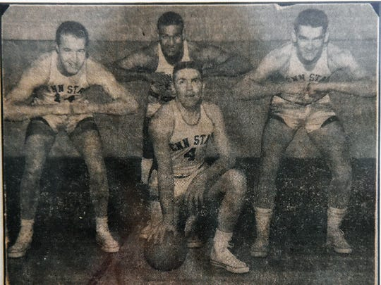 This undated newspaper clipping shows the four Penn State football players who also played for the university's basketball team, as seen in Bobby Hoffman's Lititz home in February. From left to right in the photo are Jack Sherry, Jesse Arnelle, Bob Rohland and Hoffman. Hoffman was a defensive back and quarterback for Penn State's 1954 football team, and also helped lead the men's basketball team to its only Final Four appearance.