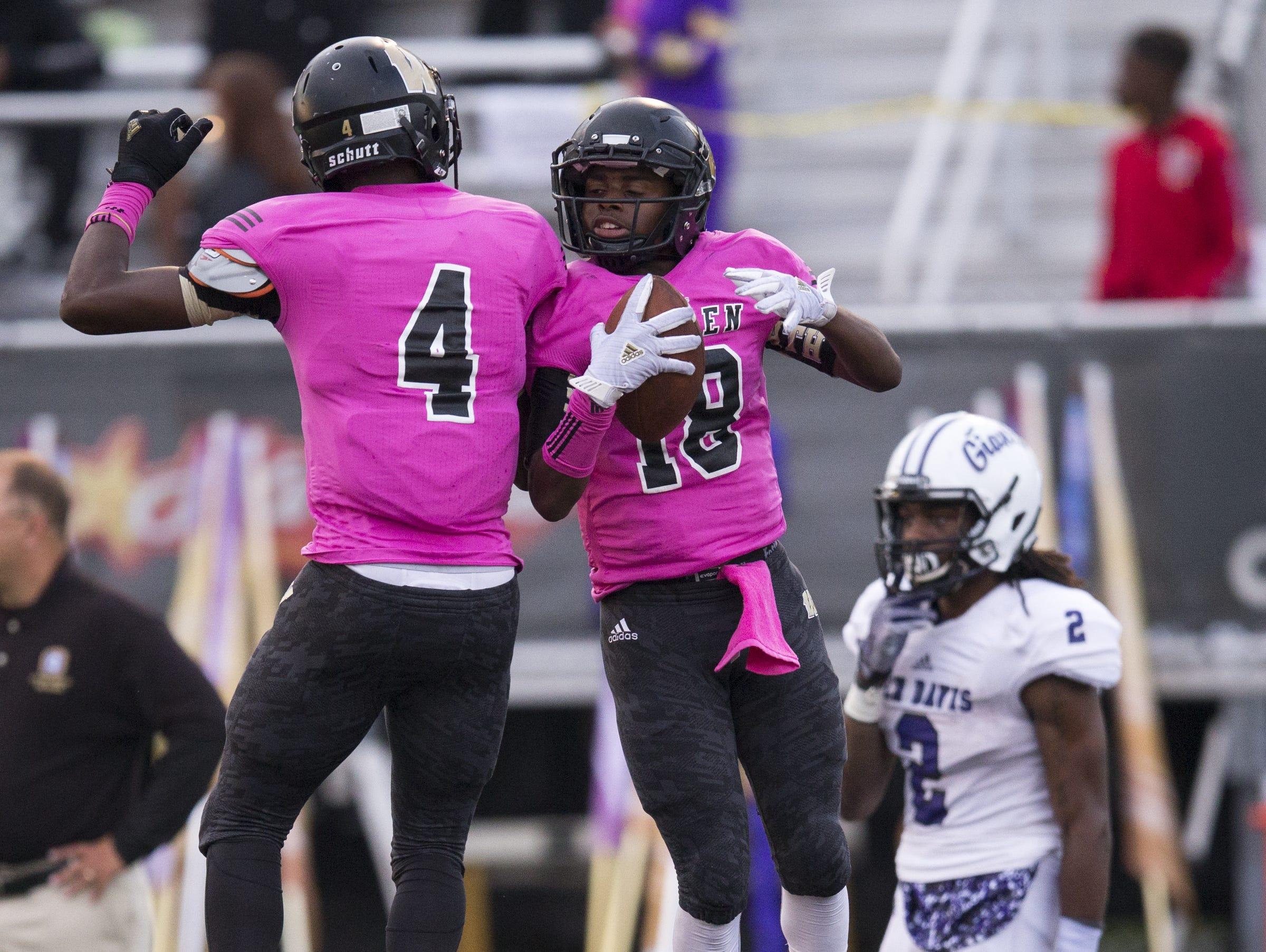 David Bell (left), and Warren Central High School teammate Dajour Griffie celebrate Griffie's first half touchdown, Ben Davis at Warren Central High School football, Indianapolis, Friday, Sept. 16, 2016. WCHS won 35-34.