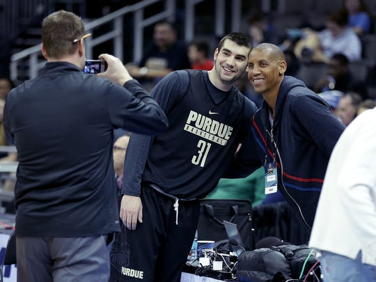 Purdue guard Dakota Mathias (31) gets his photo taken with former Indiana Pacer great and now TNT's Reggie Miller during their NCAA Midwest Regional practice Wednesday at the Sprint Center in Kansas City.