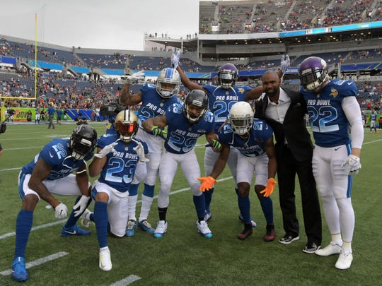 Charles Woodson poses with NFC defensive backs Keanu Nea of the Atlanta Falconsl (22), Marshon Lattimore of the New Orleans Saints (23), Darius Slay of the Detroit Lions (23), Earl Thomas of the Seattle Seahawks (29), Patrick Peterson of the Arizona Cardinals (21) and Harrison Smith of the Minnesota Vikings (22) in the 2018 NFL Pro Bowl at Camping World Stadium on Sunday, Jan. 28, 2018.