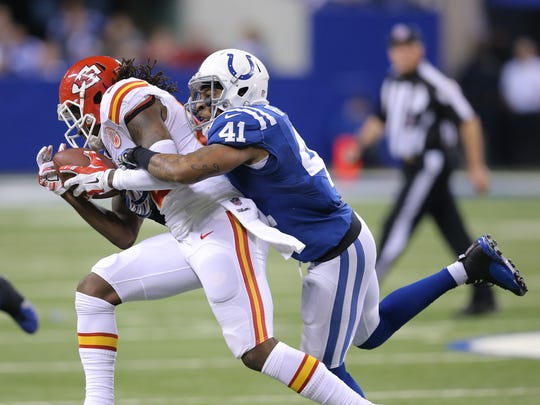 Indianapolis Colts Antoine Bethea rides the back of Kansas City Chiefs Junior Hemingway during the AFC Playoff game Jan. 4, 2014, at Lucas Oil Stadium.