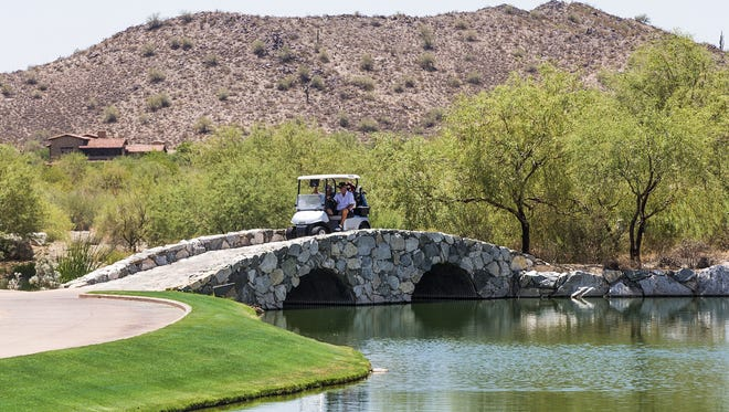 Golfers at Verrado Golf Club in Buckeye in July 2015. Verrado is a large HOA-managed community in Buckeye that offers housing, recreation and some commercial development.