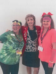 """Margi Loza, Wendy Lorenz and Melissa Day meet at the 2017 Business Expo, with the theme of """"I Love the '80s."""""""