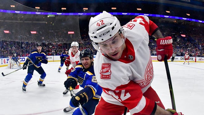 Red Wings right wing Martin Frk handles the puck as Blues left wing Alexander Steen defends during the first period at Scottrade Center.