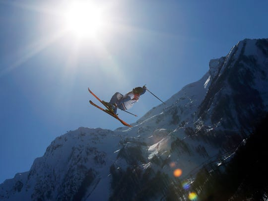 A competitor takes a jump during a ski slopestyle training session at the Rosa Khutor Extreme Park, prior to the 2014 Winter Olympics, Feb. 5, 2014, in Krasnaya Polyana, Russia.