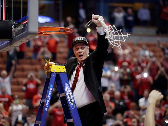 Wisconsin head coach Bo Ryan celebrates after cutting down the net after a regional final NCAA college basketball tournament game against Arizona, March 29, 2014, in Anaheim, Calif. Wisconsin won 64-63 in overtime.