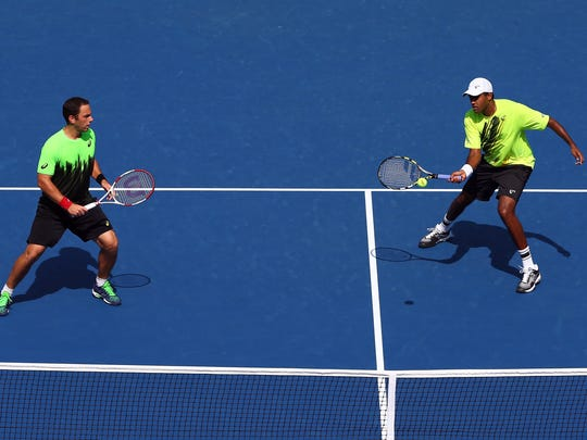 Rajeev Ram (right)  and Scott Lipsky in a quarterfinal men's doubles match of the 2014 U.S. Open, at the USTA Billie Jean King National Tennis Center on September 2, 2014 in New York City.