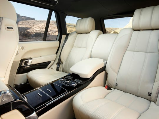 The 2014 Land Rover Range Rover LWB brings private-jet luxury to roads and off-roads with increased legroom and a 17-degree rear seat recline angle.