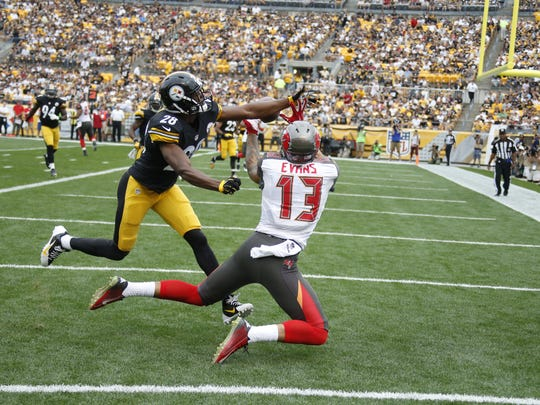Tampa Bay Buccaneers wide receiver Mike Evans (13) catches a touchdown pass as Pittsburgh Steelers cornerback Cortez Allen (28) defends on Sunday, Sept. 28, 2014 in Pittsburgh.