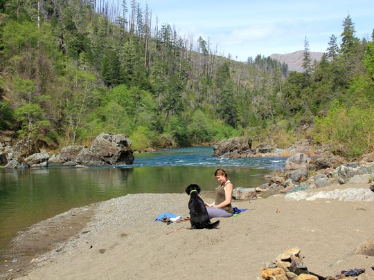 The Illinois River carves wild and scenic through the canyons of southwest Oregon's Siskiyou Mountains and Kalmiopsis Wilderness area between Grants Pass and Cave Junction. Seen here are sandy beaches in the Store Gulch Campground area. Photo taken April 18, 2014.