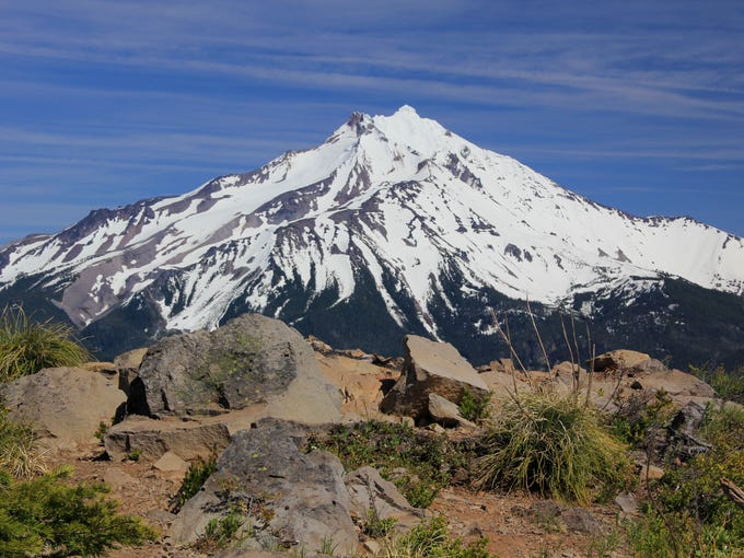 The summit of Triangulation Peak features views of Mount Jefferson and the surrounding Cascades.