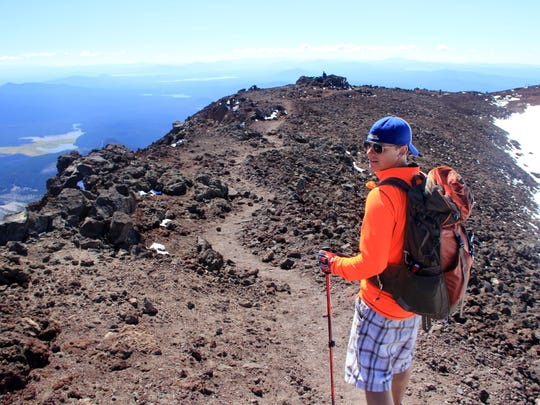 Adam Rosalez hikes around a trail that circles the summit crater of South Sister, Oregon's third tallest mountain.