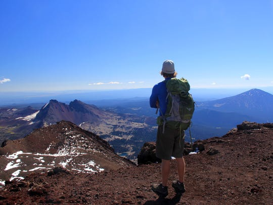 A trail around the upper crater of South Sister offers views in every direction. Seen here is Andy Gonerka.