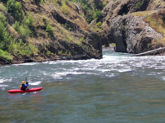 Pete Biskind kayaks through the former site of Condit Dam, which was removed from the White Salmon River in 2011. The removal opened up a new section of river to rafters and kayakers.
