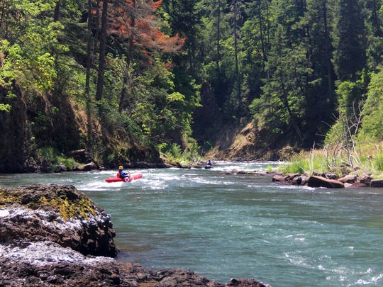 """Pete Biskind kayaks through the White Salmon River's """"lower lower section,"""" which was opened up to paddlers by the removal of Condit Dam in 2011."""