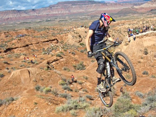Thomas Genon, from Belgium, performs a 360 spin during the last run of the Red Bull Rampage Monday, Sept. 29, 2014.