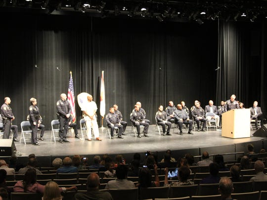 Tallahassee Police Chief Michael DeLeo promoted 15 officers Monday including Maj. Lonnie Scott.