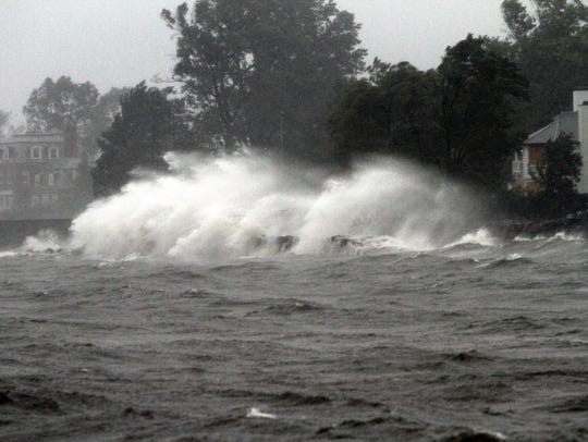 Waves pound the shoreline in Mamaroneck during Hurricane