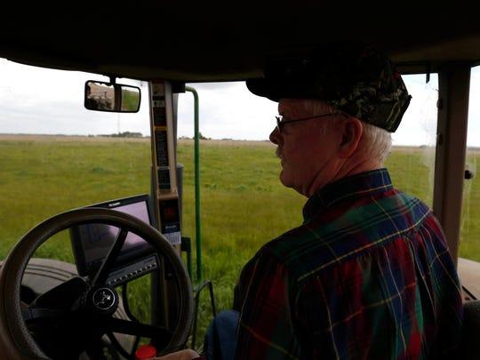 Richard Roorda drives his John Deere tractor across