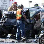 Emergency crews tend to victims of a traffic accident along the eastbound lanes of Interstate 10 near the junction with Trans Mountain Road on Wednesday.
