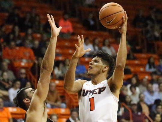 UTEP forward Paul Thomas, 1, shoots over the outstretched