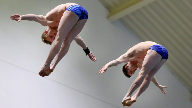 Steele Johnson and David Boudia dive during the synchronized men 10m platform event during the 2015 USA Diving Winter National Championship at the Natatorium at IUPUI on Dec. 16, 2015.