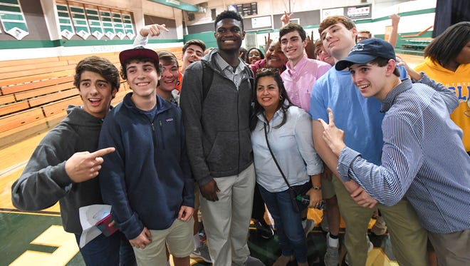 Spartanburg Day's Zion Williamson  poses for photos and signs autographs for fans after his team played Shannon Forest in Greenville on Tuesday, January 24, 2017.