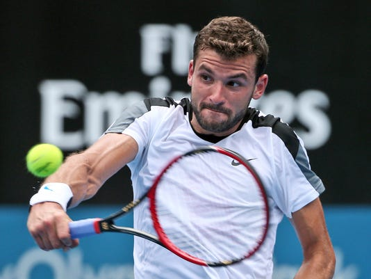 Grigor Dimitrov of Bulgaria plays a shot in his quarterfinal match against Alexandr Dolgopolov of Ukraine during the Sydney International tennis tournament in Sydney, Thursday, Jan. 14, 2016. (AP Photo/Rob Griffith)