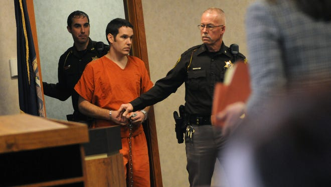 Nathan Clark is brought into the courtroom Monday, Feb. 8, during sentencing in Judge Lane's courtroom.