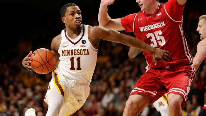 Minnesota guard Isaiah Washington (11) drives on Wisconsin forward Nate Reuvers (35) during the first half of an NCAA college basketball game Wednesday, Feb. 6, 2019, in Minneapolis. (AP Photo/Andy Clayton-King)
